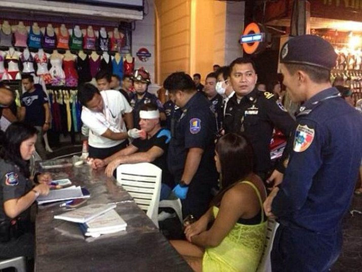 """Pic shows: Irish tourist Michael Merry (with the injury in the head) and the ladyboy surrounded by police. An Irish tourist was given a savage beating by a lady boy in Thailand after he told her to get lost when she suggested they have some fun together. According to eyewitnesses the Irishman, named as 55-year-old Michael Merry, had been approached by the lady boy transvestite at 3am while he was walking down the street in Thailand's holiday resort of Pattaya. The area is a coastal resort town east of Bangkok that is infamous for its seedy night life scene and high crime rate. Local police spokesman Piyapong Ensan said that the attacker had been identified as transgender person Wichai Sripalang, 24, who had had suggested that the Irishman might like to have some fun with her. The police spokesman said: """"The transgender woman who approached him and offered sexual services, he declined the offer but she then put her arms around him and molested him. This annoyed him and he shoved her away, causing her to fall to the ground. When she stood up she took of one of her shoes, and used it to hit the victim over the head."""" According to medics the high-heeled shoe had left a deep wound in the tourists head, and she has been charged with physical assault. She was still at the scene when officers arrived. The Irishman was treated at the scene, and the lady boy who was questioned over the incident faces a fine. In a similar incident, a transgender prostitute was arrested for allegedly attacking a Polish woman with a high-heel shoe. According to police, the suspect was arguing with the victim after she attempted to offer sexual service to the victim's husband. (ends)"""